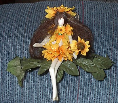 brownhairedsunflowerfaeshelf.jpg